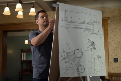 Peter with schematics of The Machine.
